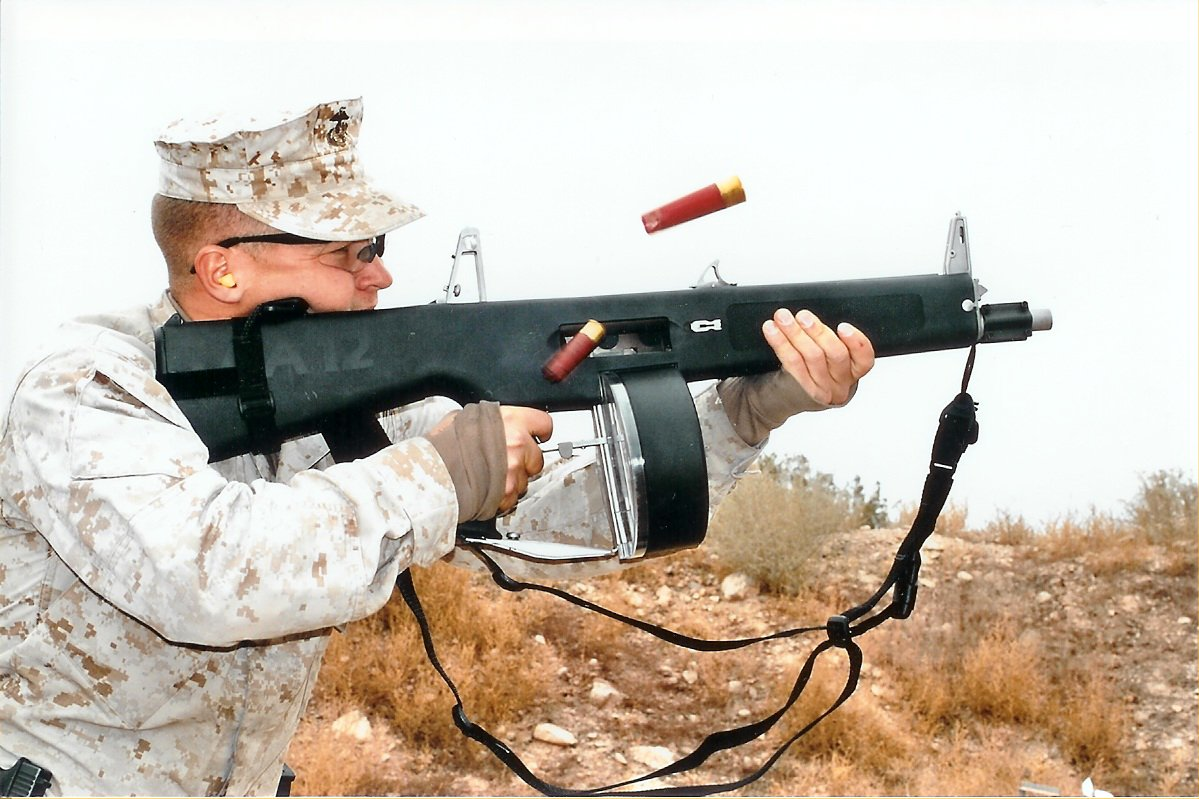 U.S.%20Marine%20Firing%20AA 12%20Full Auto%20Shotgun%20%28AA12%20Machine%20Shotgun%29 <!  :en  >Exclusive Video: AA12 Machine Shotgun/FRAG 12 Grenade Weapon System Test Fired<!  :  >