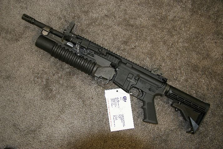 Arms%20at%20NDIA%20Small%20Arms%20Symposium Colt%20LMG SAW M203 <!  :en  >Colt Introduces New Mag Fed IAR Type Weapon at NDIA Small Arms Symposium 2006<!  :  >