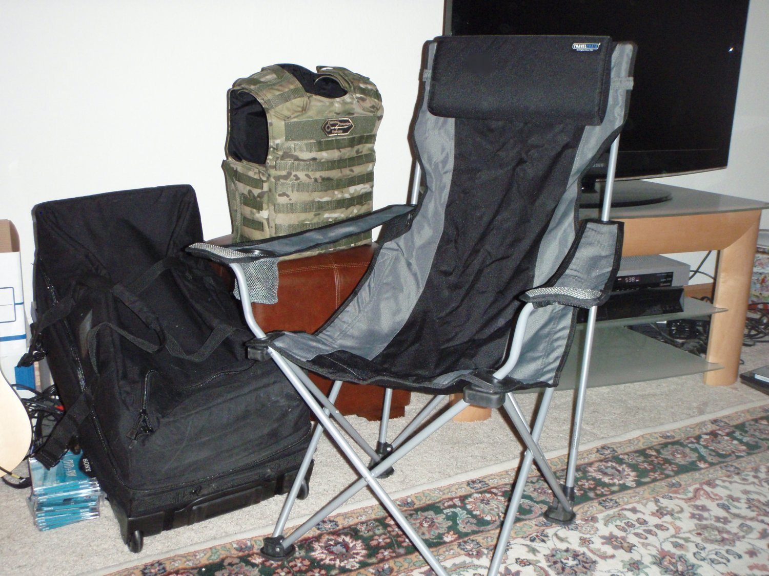 TravelChair 1 <!  :en  >TravelChair Portable Folding Lounge Chairs for Tactical Travel Applications<!  :  >