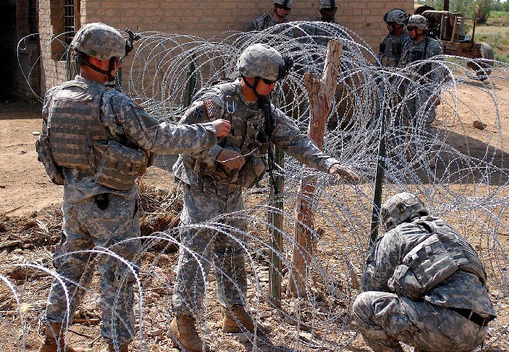 us security fence concertina wire 1 <!  :en  >The Afghanistan Security Solution (Long Term):  AFPAK Border Security Fence Needed, Not More U.S. Troops<!  :  >