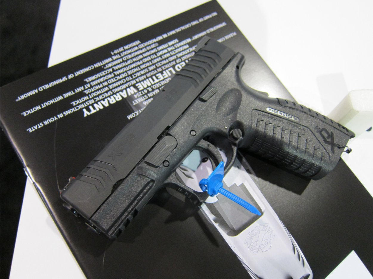 SHOT Show 2010 Springfield Armory XDM 9 3.8 Compact Pistol 1 Rotated <!  :en  >Springfield Armory XDM 9 3.8 Short Barrel High Capacity Compact 9mm Pistol for Concealed Carry (CCW): 20 (19+1) Rounds of Immediate Firepower!<!  :  >