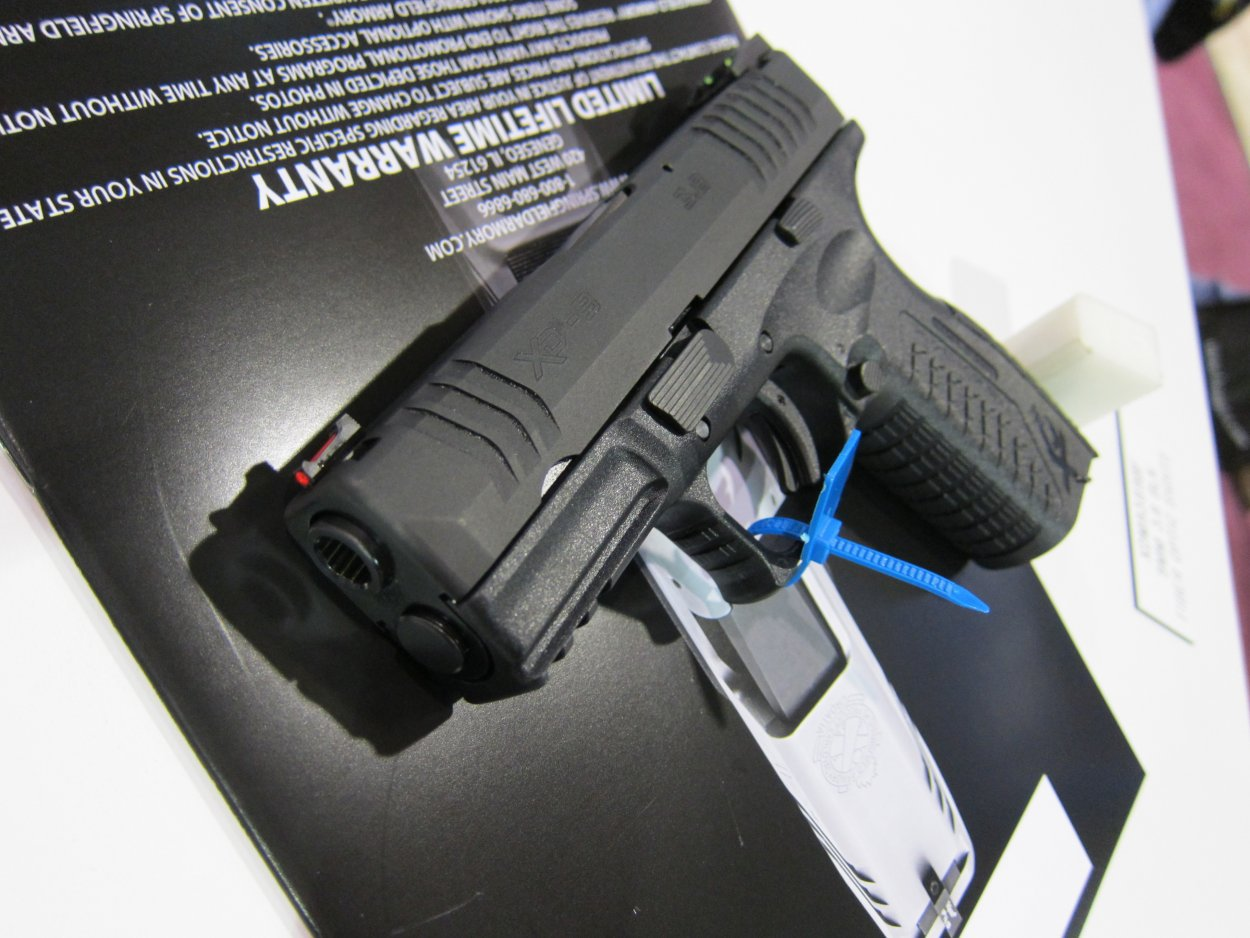 SHOT Show 2010 Springfield Armory XDM 9 3.8 Compact Pistol 4 Rotated <!  :en  >Springfield Armory XDM 9 3.8 Short Barrel High Capacity Compact 9mm Pistol for Concealed Carry (CCW): 20 (19+1) Rounds of Immediate Firepower!<!  :  >