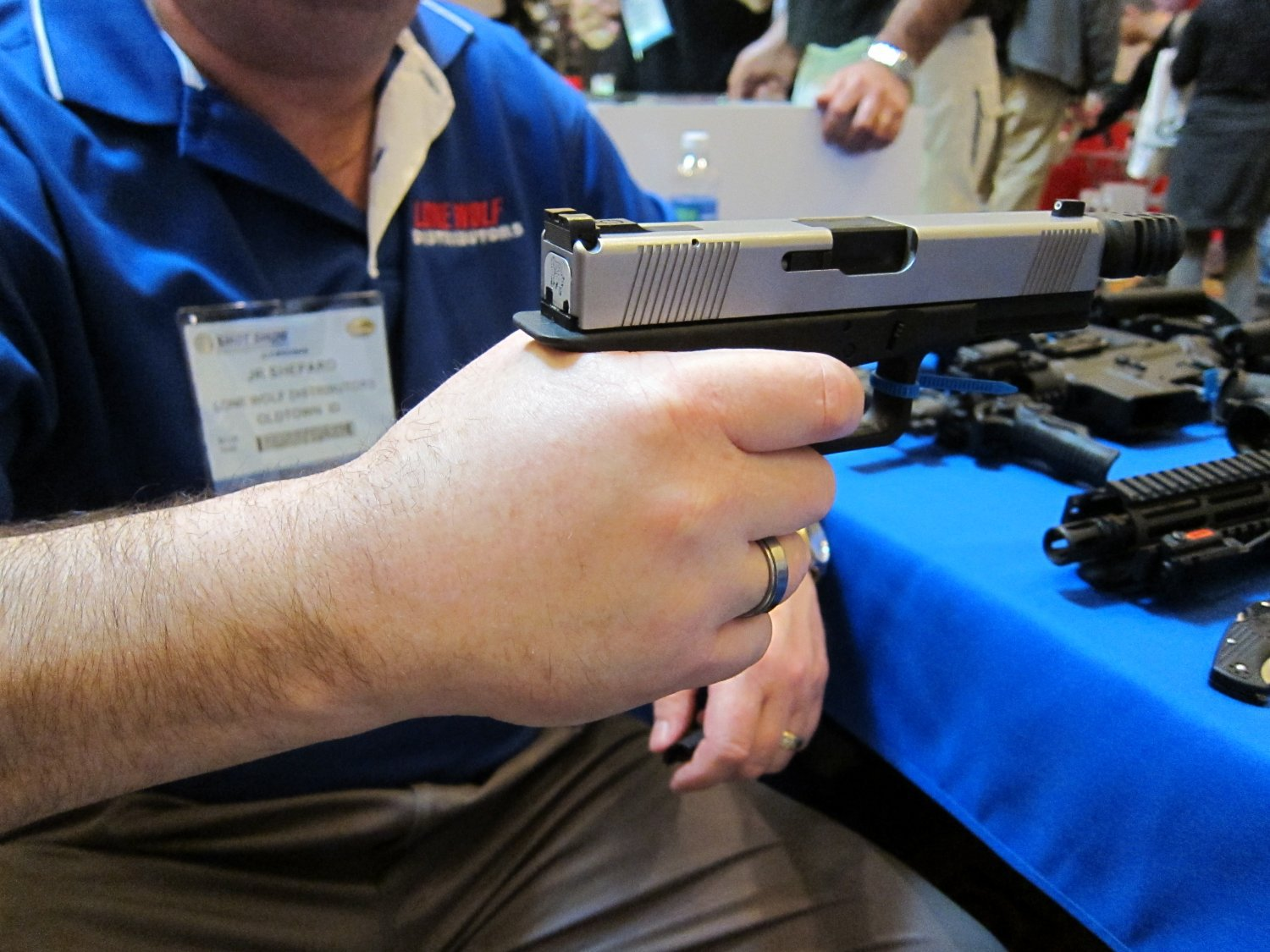 SHOT Show 2010 Lone Wolf 1911 Style Glock 17 Frame 6 <!  :en  >Lone Wolf 1911 Style Glock 17/22 (G17/22) Pistol Frame (Polymer Grip Frame) with Extended Beavertail Tang: Glock Meets 1911 Pistol for the Best of all Worlds? (Pics!)<!  :  >