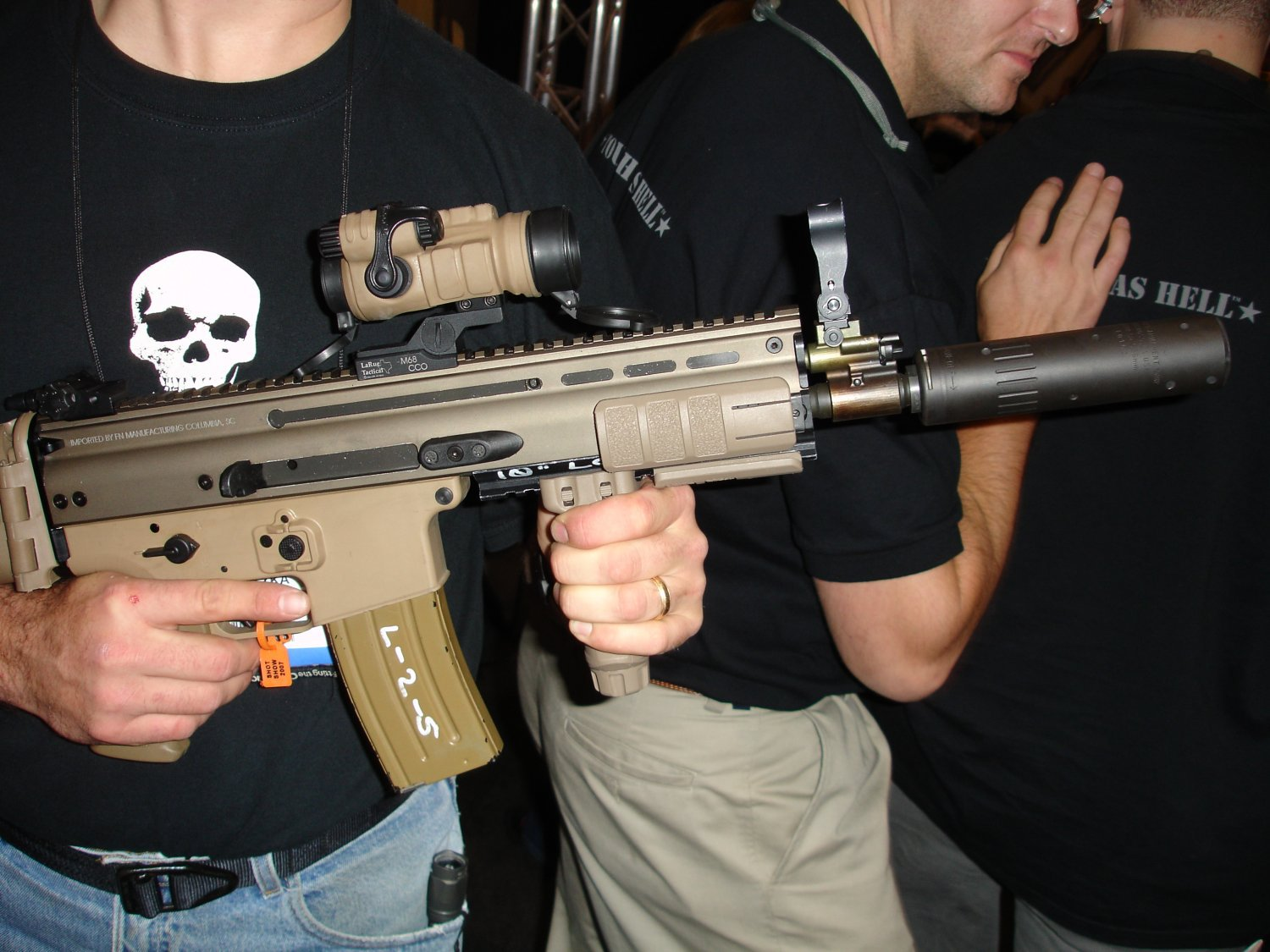 FN MK16 SCAR L with AAC Silencer Sound Suppressor SHOT Show 2007 1 <!  :en  >SOCOM Cancels FN Mk 16 SCAR L (SCAR Light) 5.56mm NATO Rifle/Carbine/SBR Weapons Program. Will the FN Mk 17 SCAR H (SCAR Heavy) 7.62mm NATO Variant Survive? Only the Shadow Knows. <!  :  >
