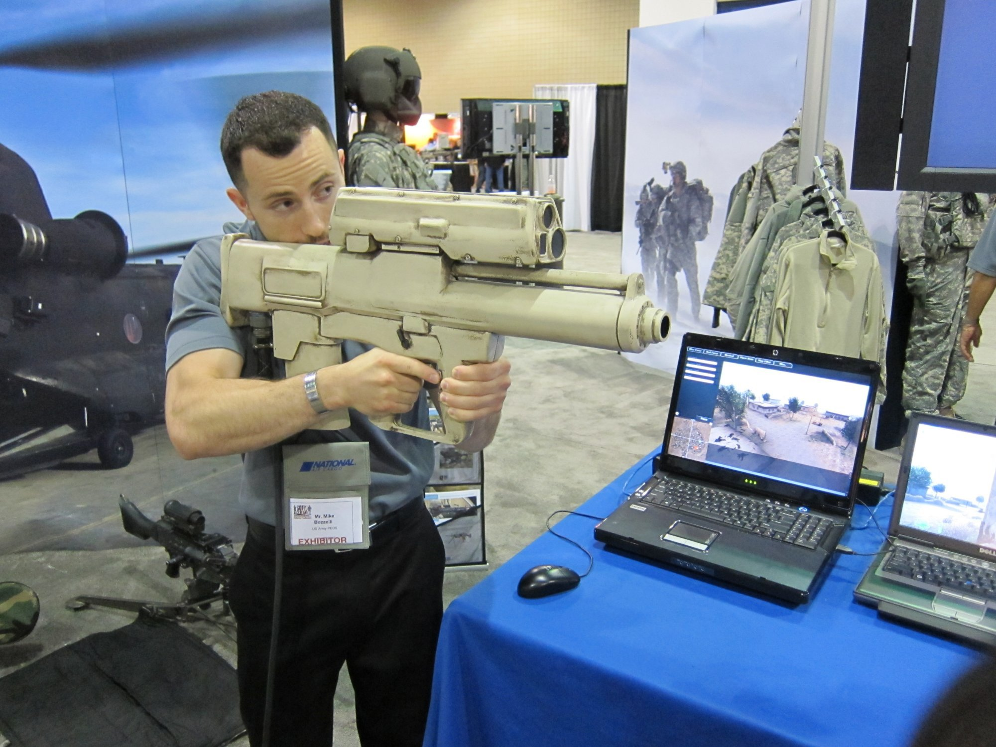 ATK XM25 Auto 25mm Grenade Launcher Weapon Simulator System SOFIC 2010 3 <!  :en  >ATK XM25 Game Changer Semi Auto 25mm Airburst Grenade Launcher/Individual Airburst Weapon System (IAWS) Goes to Combat: DR Provides the Cool Skinny on this Potentially Revolutionary Infantry Weapon System.<!  :  >