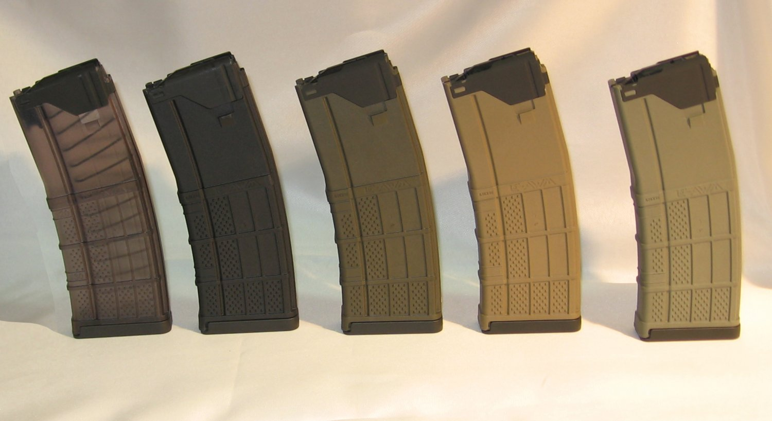 Lancer Systems L5 Advanced Warfighter Magazine L5 AWM 3 <!  :en  >Lancer Systems L5 Advanced Warfighter Magazine (Lancer L5 AWM) 30 Round 5.56mm NATO Translucent Polymer AR Mag (AR 15/M16 Rifle Magazine) to Debut at SHOT Show 2011  <!  :  >