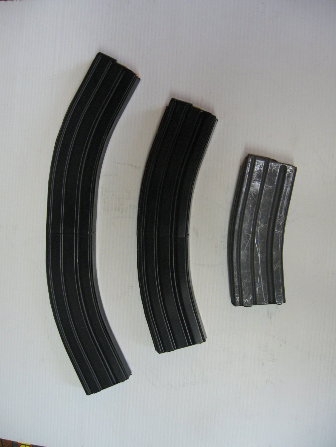 Higher Capacity 55 Round and 75 Round AR 15 5.56mm Rifle Magazines Company Shot <!  :en  >Higher Capacity 55 Round 5.56mm NATO and 32 Round 7.62mm NATO Rifle Magazines for Tactical AR (AR 15 and SR 25 type) and M14/M1A Rifles/Carbines/SBRs  (Photos and Video!) <!  :  >