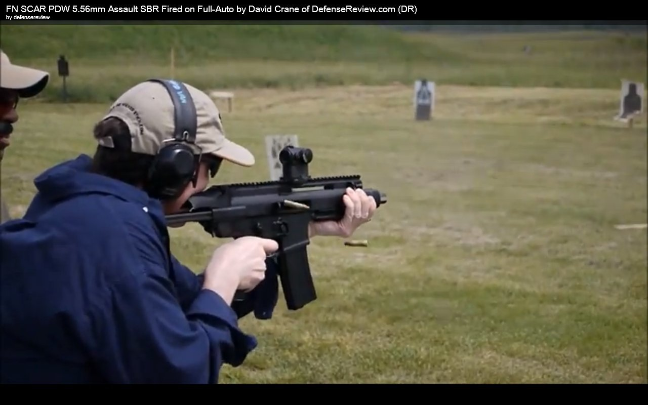 David Crane Running FN SCAR PDW at NDIA Infantry Small Arms Systems Symposium 2011 Range Day Shoot 2 <!  :en  >DR Action Video! More FN SCAR PDW (Personal Defense Weapon) Prototype Live Fire Videos: Left Side View Shows Reciprocating Charging Handle Cycling Back and Forth <!  :  >