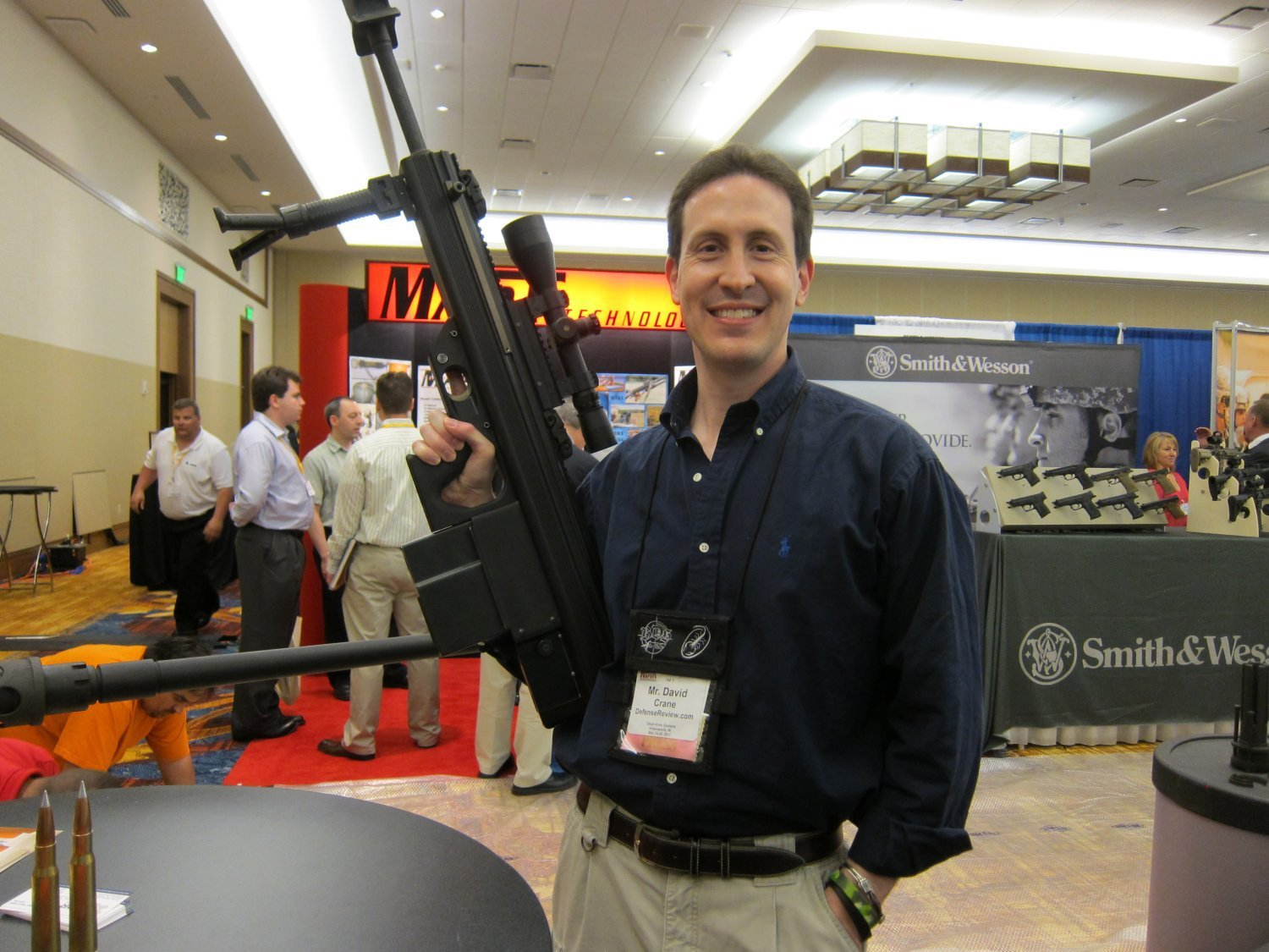 David Crane of DefenseReview.com Holding Micor Leader 50 Lightweight Bullpup Semi Auto .50 BMG Sniper Anti Materiel Rifle NDIA Small Arms Symposium 2011 1 <!  :en  >MICOR Defense Leader 50 Ultra Compact, Lightweight Bullpup Semi Auto .50 BMG (12.7x99mm NATO) Sniper/Anti Materiel Rifle and PNW Arms Weapons Science .50BMG Ammo at NDIA Infantry Small Arms Systems Symposium 2011: Potential Long Range Lethality Game Changer Combo for 21st Century Infantry Warfare (Photos and Video!)<!  :  >