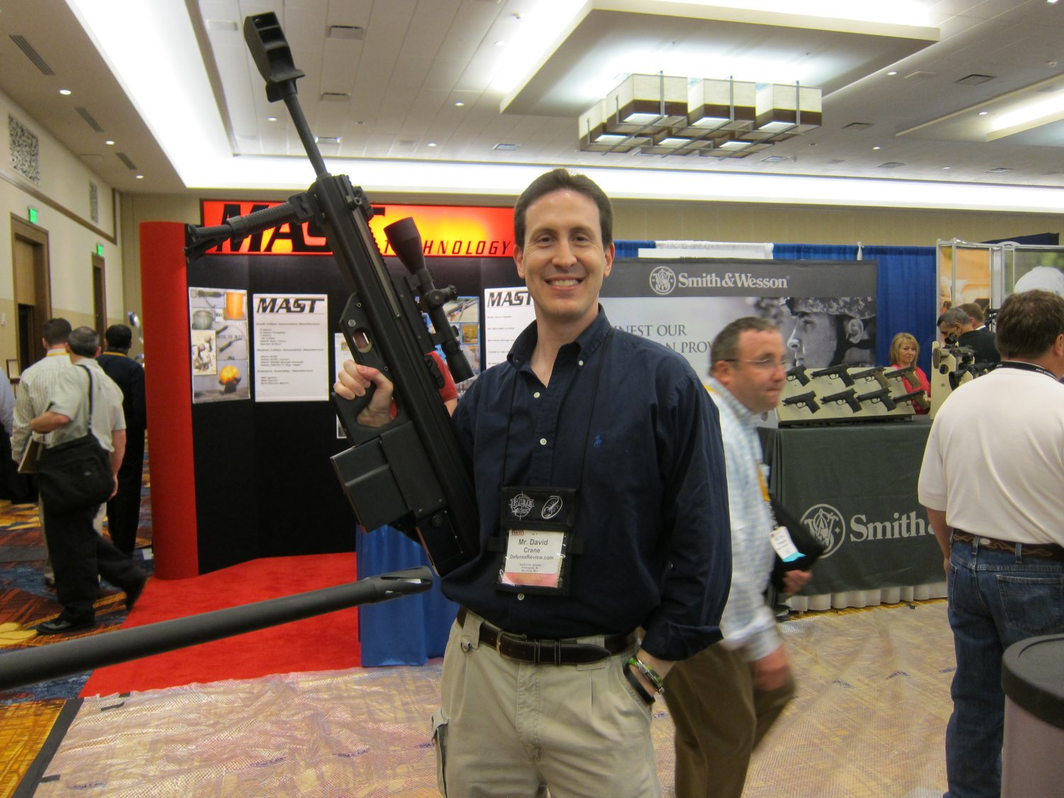 David Crane of DefenseReview.com Holding Micor Leader 50 Lightweight Bullpup Semi Auto .50 BMG Sniper Anti Materiel Rifle NDIA Small Arms Symposium 2011 3 <!  :en  >MICOR Defense Leader 50 Ultra Compact, Lightweight Bullpup Semi Auto .50 BMG (12.7x99mm NATO) Sniper/Anti Materiel Rifle and PNW Arms Weapons Science .50BMG Ammo at NDIA Infantry Small Arms Systems Symposium 2011: Potential Long Range Lethality Game Changer Combo for 21st Century Infantry Warfare (Photos and Video!)<!  :  >