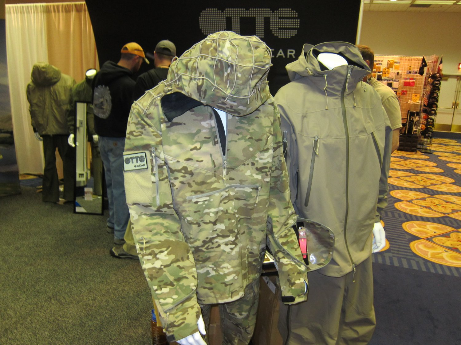 OTTE Gear Combat Anorak Hooded Pullover Tactical Softshell Jacket SHOT Show 2011 DefenseReview.com DR 1 <!  :en  >OTTE Gear Recce/Overwatch Anorak: High End, High Tech Tactical/Combat Soft Shell Hoodie Sniper Jacket (Pullover Type) with Crye MultiCam Camouflage Pattern and Ghillie Platform for Snipers, Recce Operators/Assaulters and Civilian Tactical Shooters<!  :  >