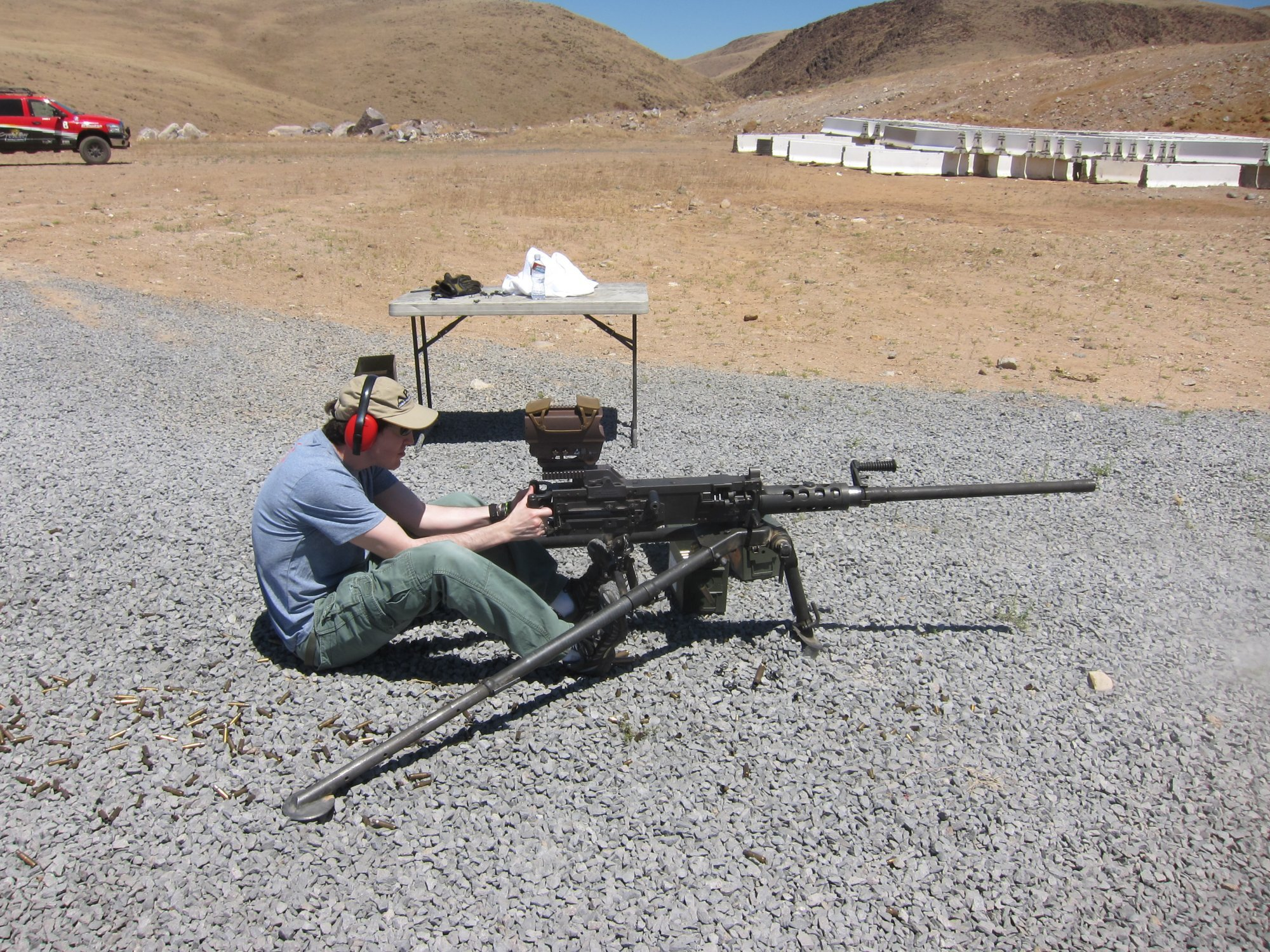 U.S. Ordnance M2HB QCB .50 BMG Heavy Machine Gun HMG David Crane Firing at Range DefenseReview.com DR 1 <!  :en  >U.S. Ordnance M2HB QCB (Quick Change Barrel) Ma Deuce .50 BMG Heavy Machine Gun (HMG) Equipped with Raytheon ELCAN SpecterHR Wide View Dual Red Dot Optical Gunsight Gets Test Fired at the Range (Video!)<!  :  >