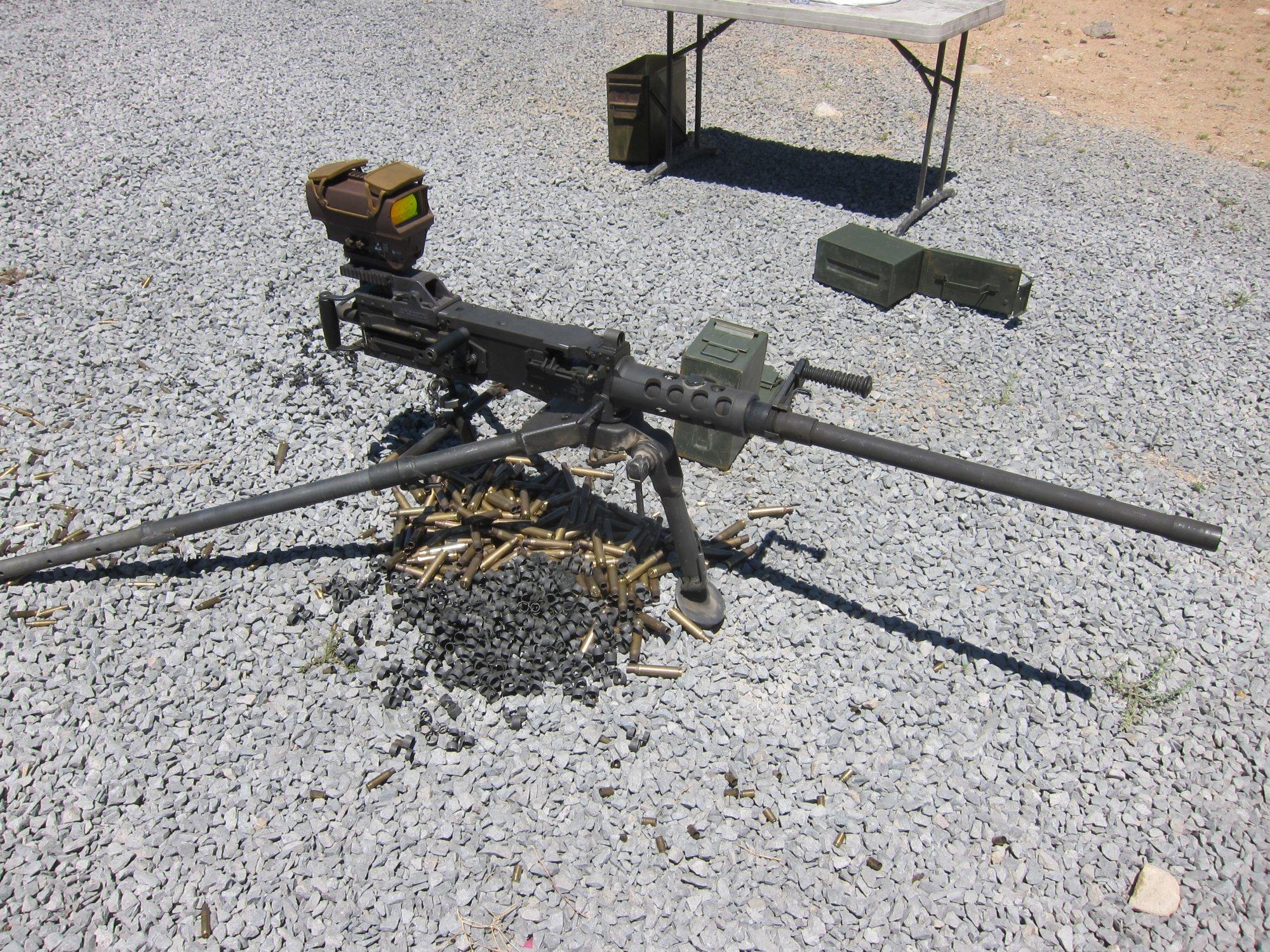 U.S. Ordnance M2HB QCB .50 BMG Heavy Machine Gun HMG David Crane Firing at Range DefenseReview.com DR 4 <!  :en  >U.S. Ordnance M2HB QCB (Quick Change Barrel) Ma Deuce .50 BMG Heavy Machine Gun (HMG) Equipped with Raytheon ELCAN SpecterHR Wide View Dual Red Dot Optical Gunsight Gets Test Fired at the Range (Video!)<!  :  >