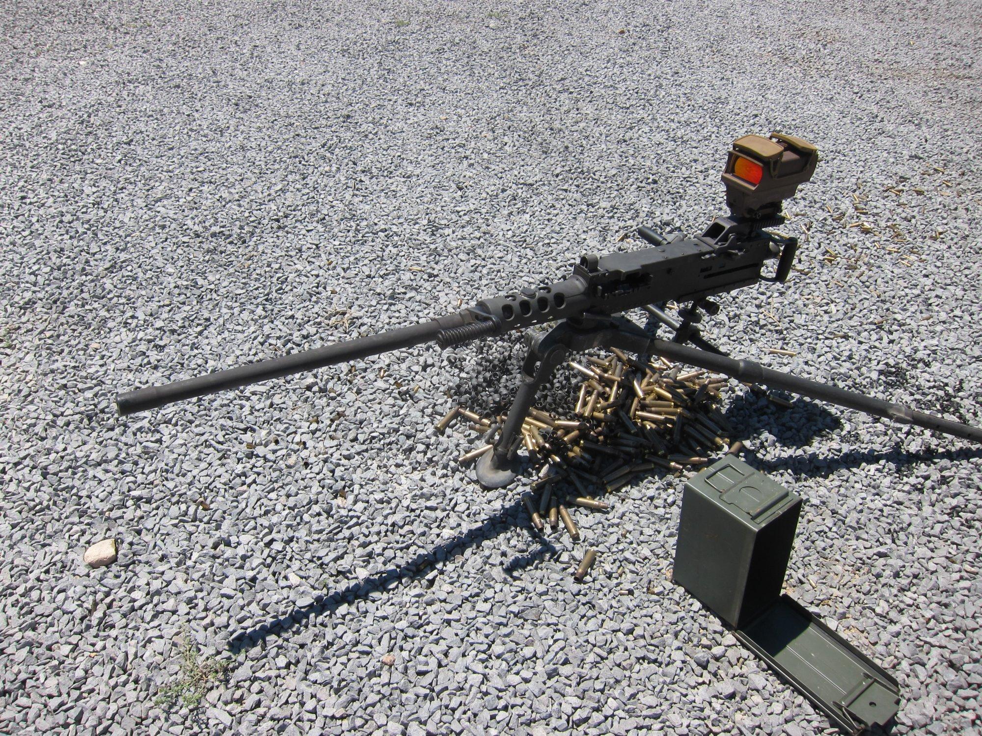U.S. Ordnance M2HB QCB .50 BMG Heavy Machine Gun HMG David Crane Firing at Range DefenseReview.com DR 5 <!  :en  >U.S. Ordnance M2HB QCB (Quick Change Barrel) Ma Deuce .50 BMG Heavy Machine Gun (HMG) Equipped with Raytheon ELCAN SpecterHR Wide View Dual Red Dot Optical Gunsight Gets Test Fired at the Range (Video!)<!  :  >