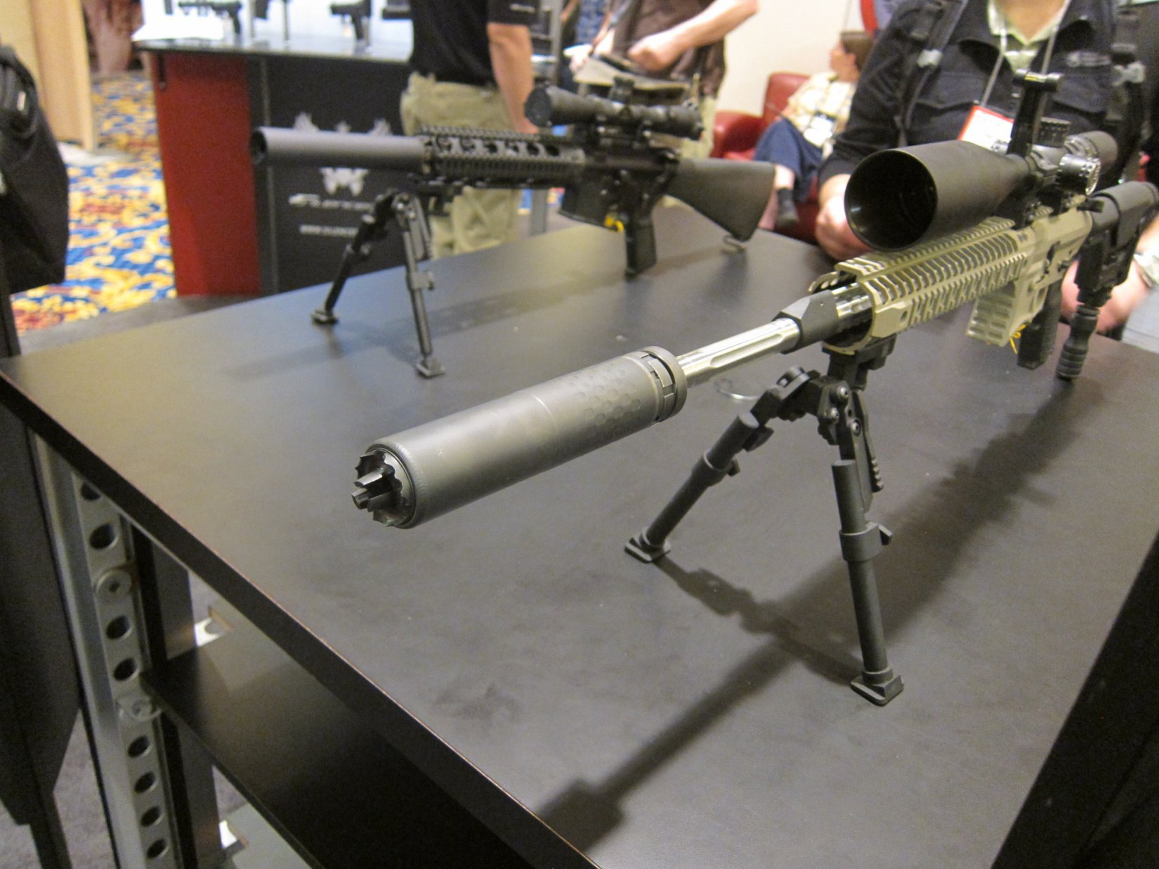 Silencerco 5.56 Saker 5.56mm NATO Silencer Sound Suppressor at SHOT Show 2012 DefenseReview.com DR 1 Silencerco Saker 5.56 Modular/Universal 5.56mm Rifle Silencer/Sound Suppressor with Trifecta Fast Attach Mount and Trifecta RS Flash Hider/Suppressor at SHOT Show 2012: Most Innovative and Modular 5.56mm Muzzle Can Ever? (Video!)