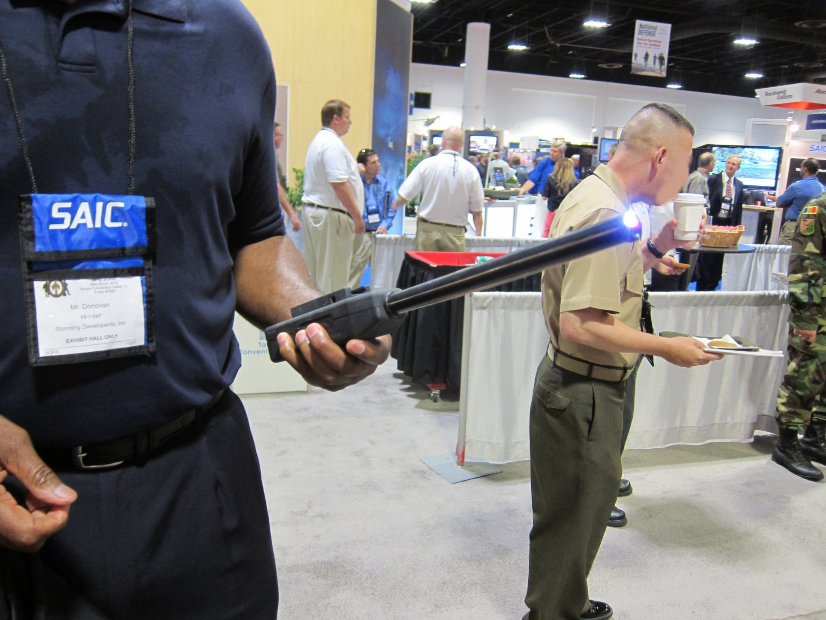 Stunning Developments BattleProd Combat Tactical Stun Baton Donovan Hunter NDIA SOFIC 2012 DefenseReview.com DR 4 Stunning Developments BattleProd Combat/Tactical Stun Baton: 3 5 Million Volt Tactical Cattle Prod for Instant Compliance in Urban Warfare Operations (Video!)