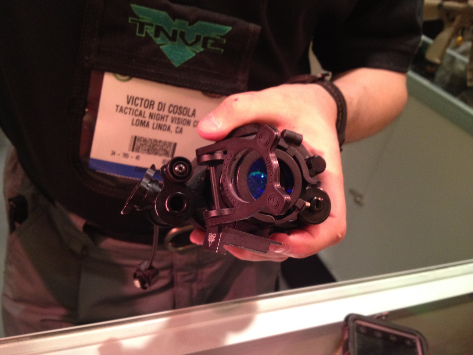 Tactical Night Vision Company Re Focus Ring TNVC RFR on PVS 14 Monocular SHOT Show 2012 David Crane DefenseReview.com DR 1 Tactical Night Vision Company (TNVC) Universal Re Focus Ring (RFR) Flip Down/Flip Up Lens for Night Observation Devices (NODS): Instantly Refocus Your Monocular or Goggle During Tactical Night Ops