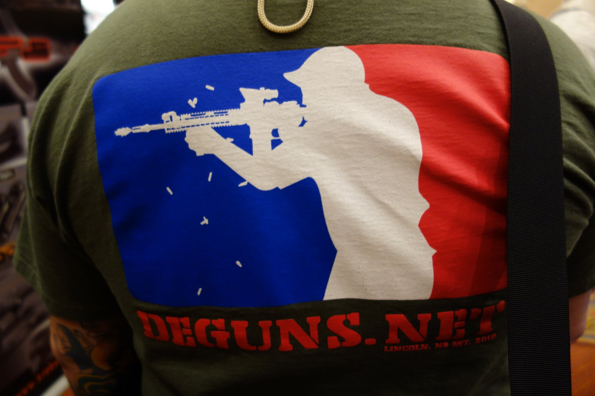 DEGUNS.net Discount Enterprises Guns Tactical Shooter Logo T Shirt SHOT Show 2013 David Crane DefenseReview.com DR 1 Cool T Shirt Alert: DEGUNS.net (Discount Enterprises Guns) Tactical Shooter Firing AR 15 Carbine Logo T Shirt