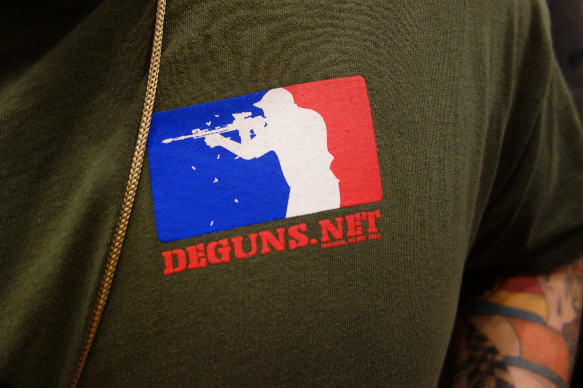DEGUNS.net Discount Enterprises Guns Tactical Shooter Logo T Shirt SHOT Show 2013 David Crane DefenseReview.com DR 2 Cool T Shirt Alert: DEGUNS.net (Discount Enterprises Guns) Tactical Shooter Firing AR 15 Carbine Logo T Shirt