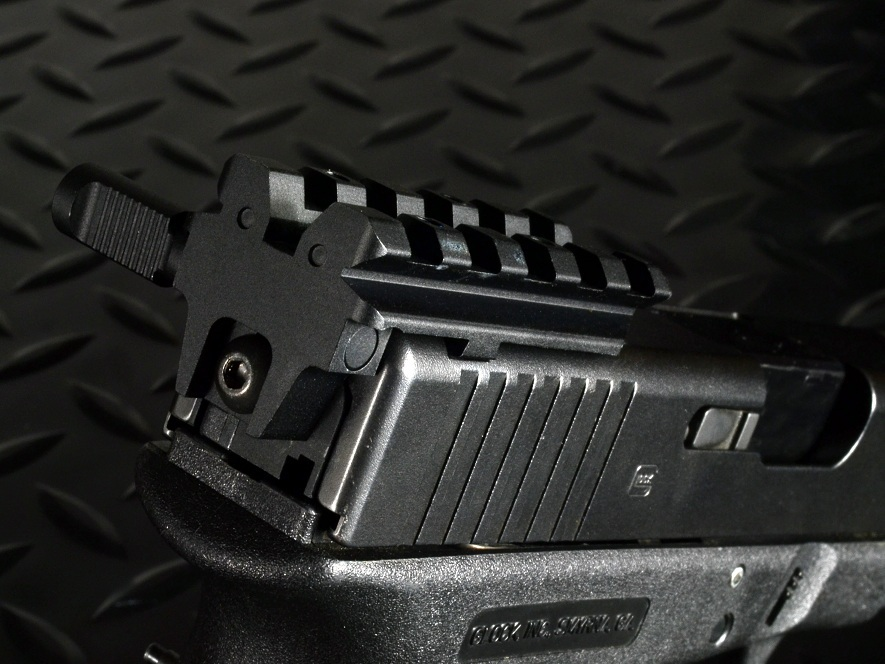Strike Industries SI Rear Sight Mount for the Glock GSR 2 Strike Industries (SI) Introduces New Glock Pistol Accessories: SI Glock Shock Buffer (GSB), SI Glock Frame Shock Buffer (GFSB), SI Glock Buffalo Wings (GBW) and SI Rear Sight Mount for the Glock (GSR)