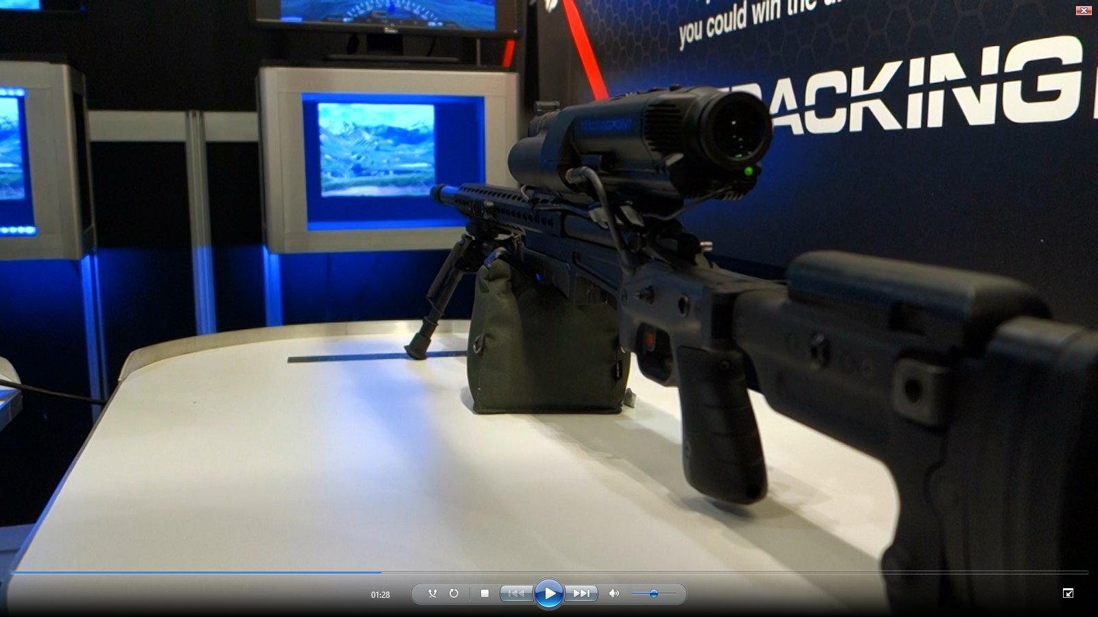 TrackingPoint XactSystem Precision Guided Firearm PGF Integrated Networked Tracking Scope Exhibit Floor SHOT Show 2013 David Crane DefenseReview.com DR 3 TrackingPoint XactSystem Precision Guided Firearm (PGF) Sniper Rifle Package with Surgeon Rifle and Integrated Networked Tracking Scope/Smart Scope Explained in Detail (Video!)