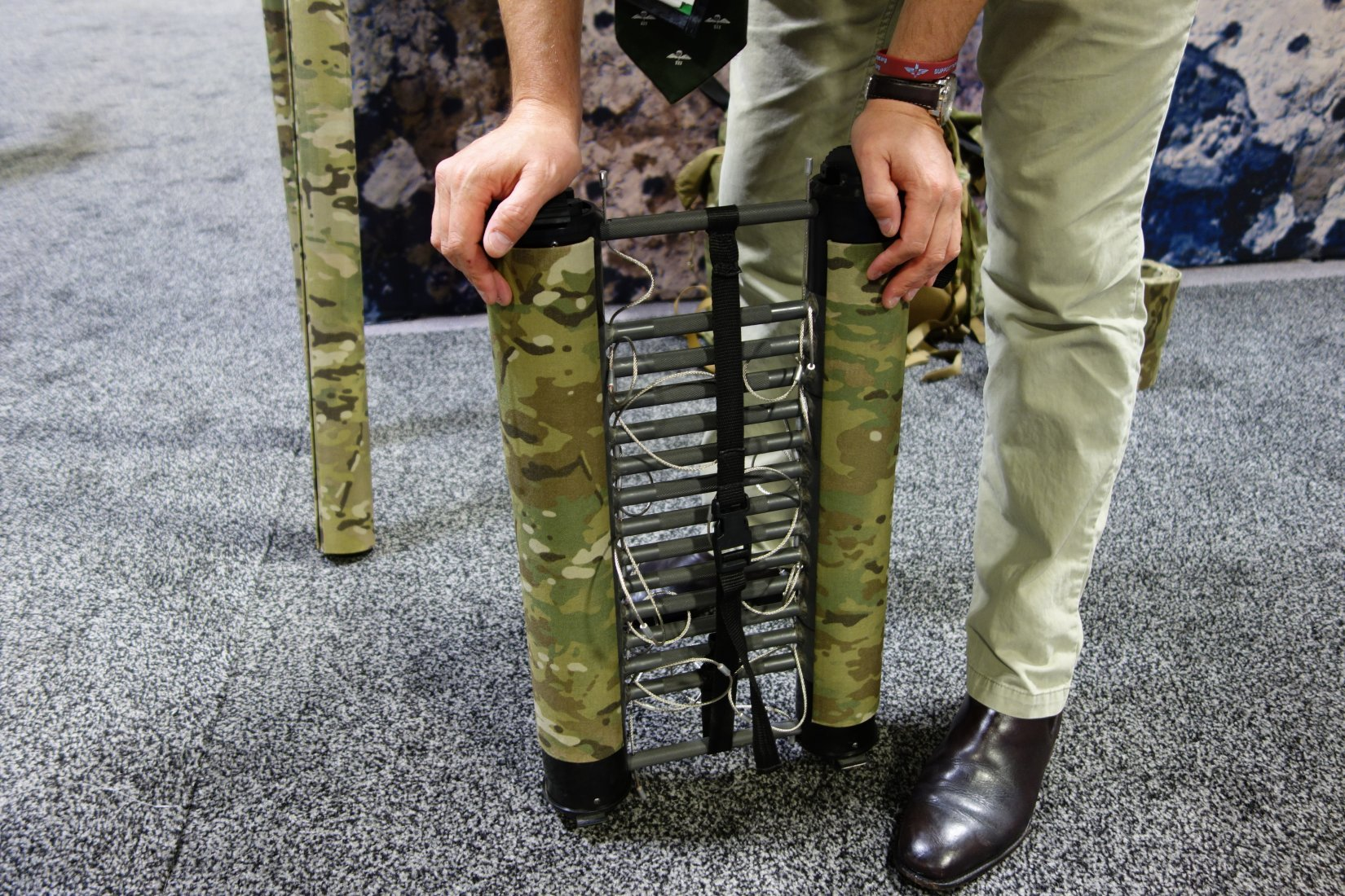 Rolatube Technology Extending Technology Lightweight Tubular Tactical Antenna and Lightweight Tubular Tactical Ladder Combat Ladder Will Pike SOFIC 2013 David Crane DefenseReview.com DR 10 Rolatube Technology Extendable/Collapsible Lightweight Tubular Tactical Ladder and Tactical Antenna Mast for Military Special Operations Forces (SOF) Combat Missions and Maritime Ops (Video!)
