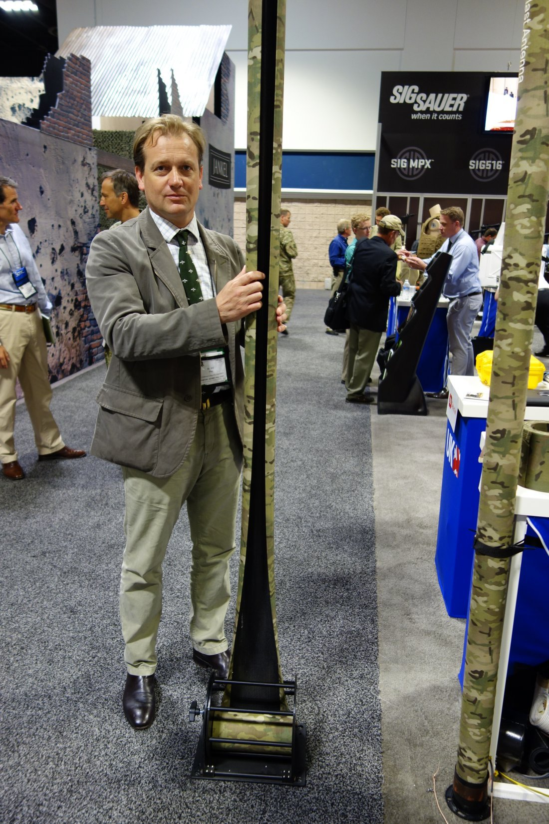 Rolatube Technology Extending Technology Lightweight Tubular Tactical Antenna and Lightweight Tubular Tactical Ladder Combat Ladder Will Pike SOFIC 2013 David Crane DefenseReview.com DR 8 Rolatube Technology Extendable/Collapsible Lightweight Tubular Tactical Ladder and Tactical Antenna Mast for Military Special Operations Forces (SOF) Combat Missions and Maritime Ops (Video!)