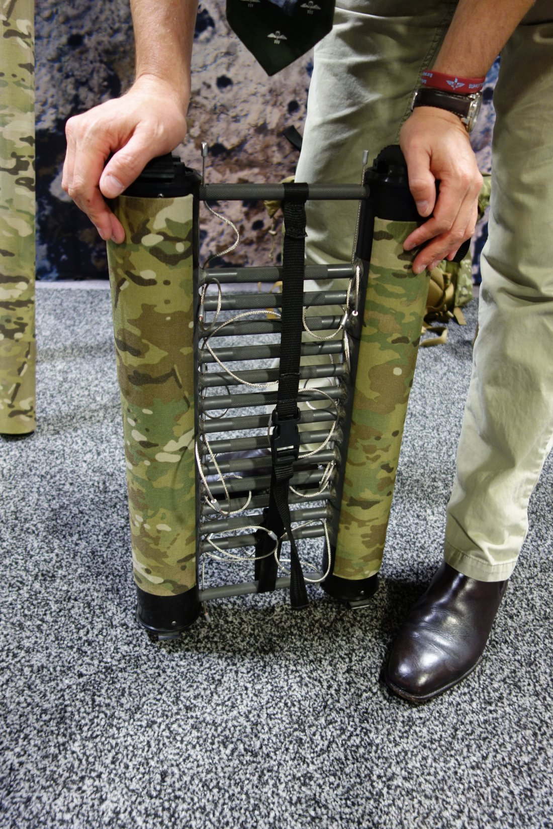 Rolatube Technology Extending Technology Lightweight Tubular Tactical Antenna and Lightweight Tubular Tactical Ladder Combat Ladder Will Pike SOFIC 2013 David Crane DefenseReview.com DR 9 Rolatube Technology Extendable/Collapsible Lightweight Tubular Tactical Ladder and Tactical Antenna Mast for Military Special Operations Forces (SOF) Combat Missions and Maritime Ops (Video!)