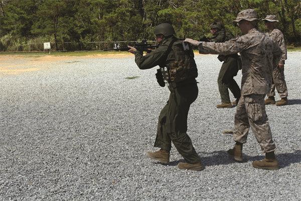 US Marine Corps Special Reaction Team USMC Dynamic CQB CQC Gunfighting Training Combat Tactical Shooting Training Lance Cpl. Nicholas S. Ranum Marine Corps Installations Pacific 1.jpg U.S. Marine Corps Special Reaction Team (USMC SRT) Receives Dynamic CQB/CQC (Close Quarters Battle/Close Quarters Combat) Gunfighting Training Focused on Enhanced Tactical TTP and Improved Tactical Carbine/Rifle and Combat Pistol Shooting Skills