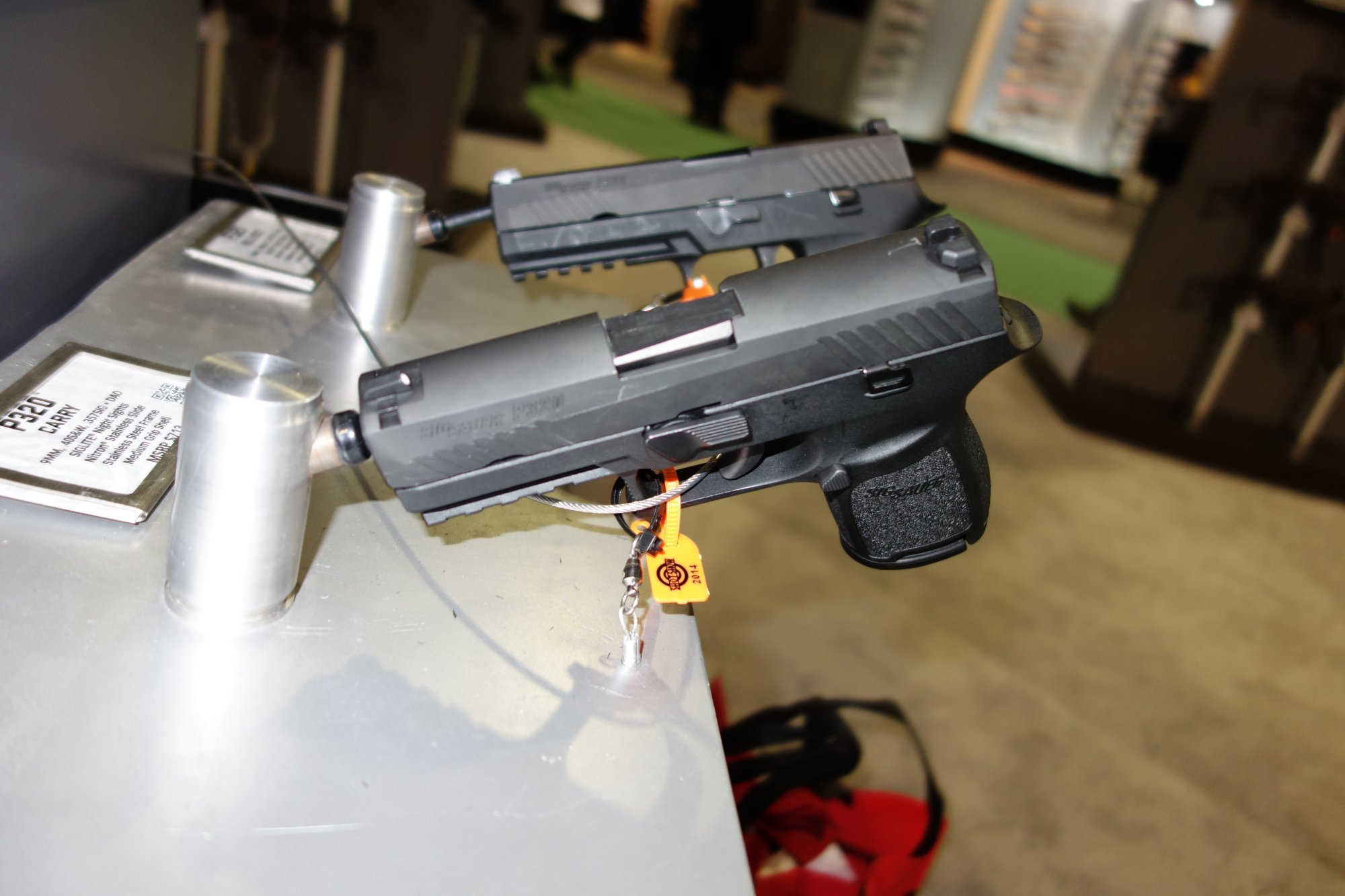 SIG SAUER P320 Carry Nitron SIG P320C Nitron Compact Combat Tactical Pistol 9mm .40 SW .357 SIG  for Concealed Carry SHOT Show 2014 1 14 14 David Crane DefenseReview.com DR 12 SIG SAUER P320 Nitron Striker Fired, Polymer Frame Semi Auto Combat/Tactical Pistol Series: Meet the SIG 320C (SIG 320 Carry/Compact) and SIG 320F (SIG 320 Full Size) 9mm/.40 S&W/.357 SIG Pistols
