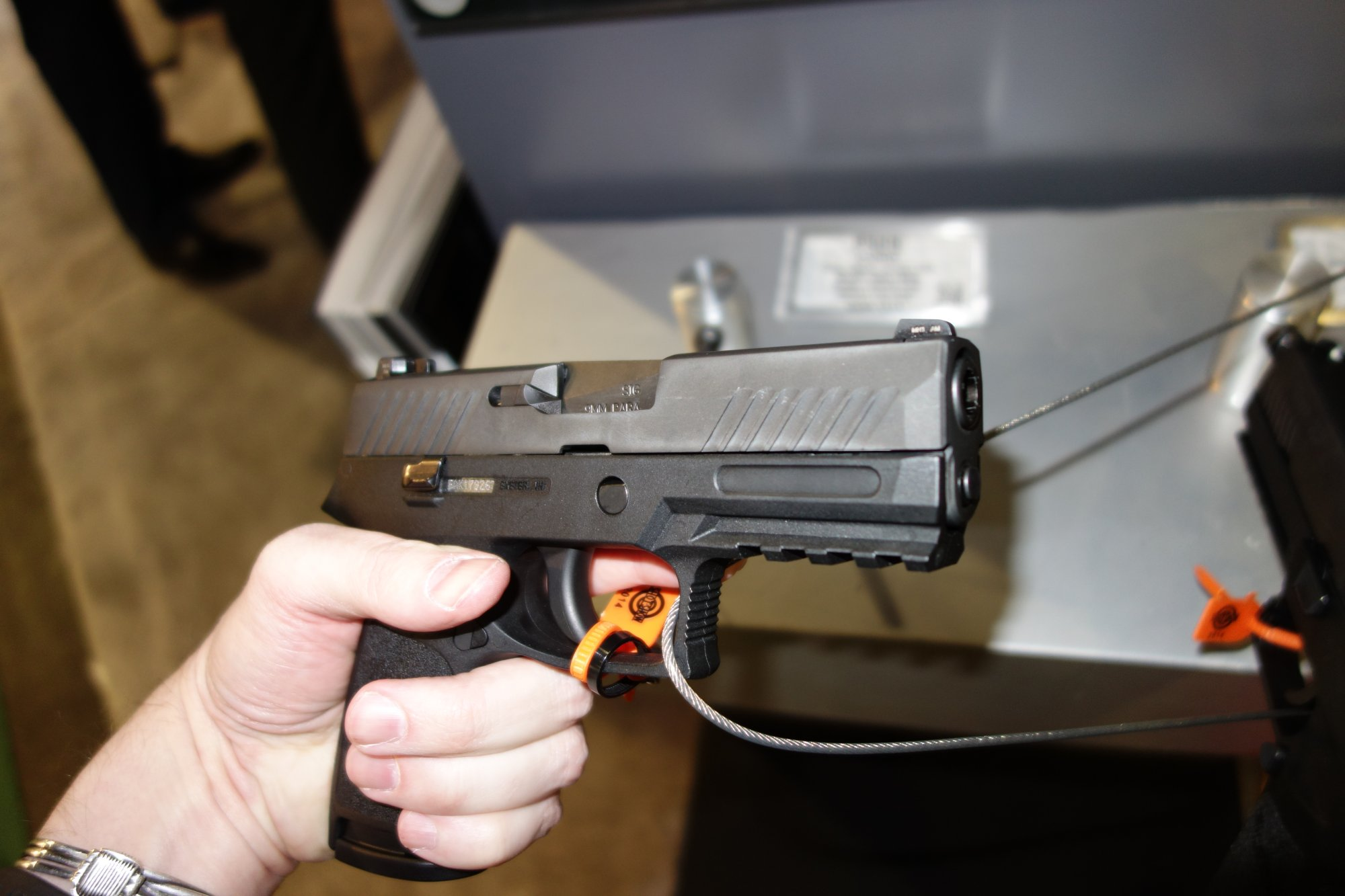 SIG SAUER P320 Carry Nitron SIG P320C Nitron Compact Combat Tactical Pistol 9mm .40 SW .357 SIG  for Concealed Carry SHOT Show 2014 1 14 14 David Crane DefenseReview.com DR 7 SIG SAUER P320 Nitron Striker Fired, Polymer Frame Semi Auto Combat/Tactical Pistol Series: Meet the SIG 320C (SIG 320 Carry/Compact) and SIG 320F (SIG 320 Full Size) 9mm/.40 S&W/.357 SIG Pistols