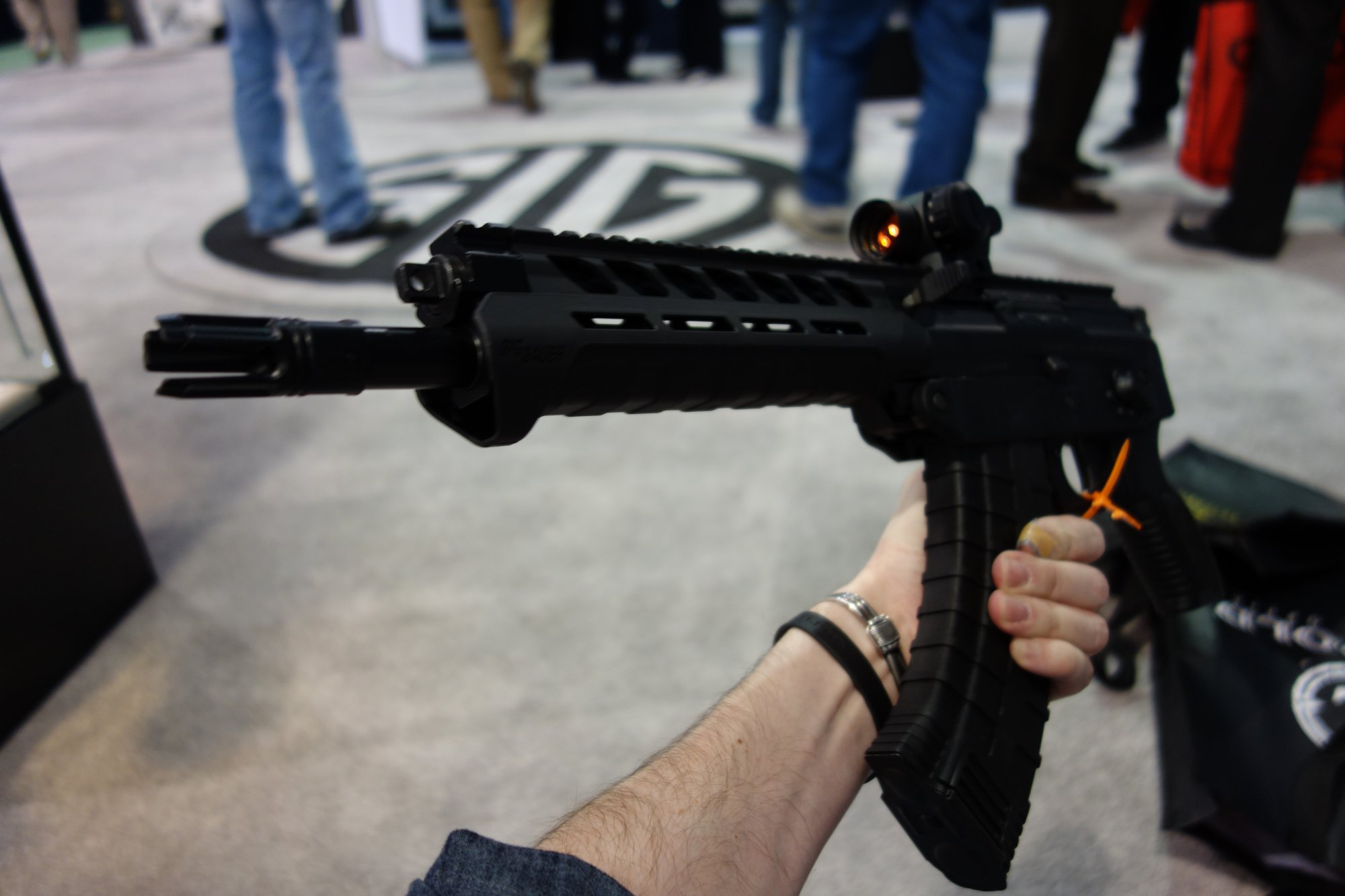 SIG SAUER SIG556xi 7.62x39mm Russian Configuration Semi Auto Only Modular Multi Caliber Combat Tactical Carbine Kalashnikov AK 47 AKM SHOT Show 2014 1 15 14 David Crane DefenseReview.com DR 10 SIG SAUER SIG556xi Modular, Multi Caliber (5.56mm NATO, 300 AAC Blackout/300BLK, 7.62x39mm Russian) Gas Piston/Op Rod Combat/Tactical Rifle/Carbine/SBR with Kalashnikov AK 47/AKM Configuration Capability!