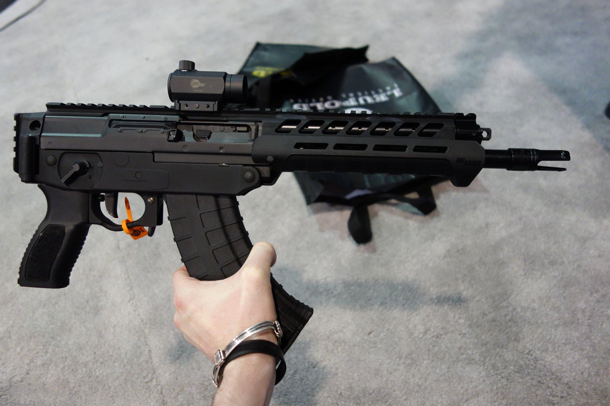 SIG SAUER SIG556xi 7.62x39mm Russian Configuration Semi Auto Only Modular Multi Caliber Combat Tactical Carbine Kalashnikov AK 47 AKM SHOT Show 2014 1 15 14 David Crane DefenseReview.com DR 13 SIG SAUER SIG556xi Modular, Multi Caliber (5.56mm NATO, 300 AAC Blackout/300BLK, 7.62x39mm Russian) Gas Piston/Op Rod Combat/Tactical Rifle/Carbine/SBR with Kalashnikov AK 47/AKM Configuration Capability!