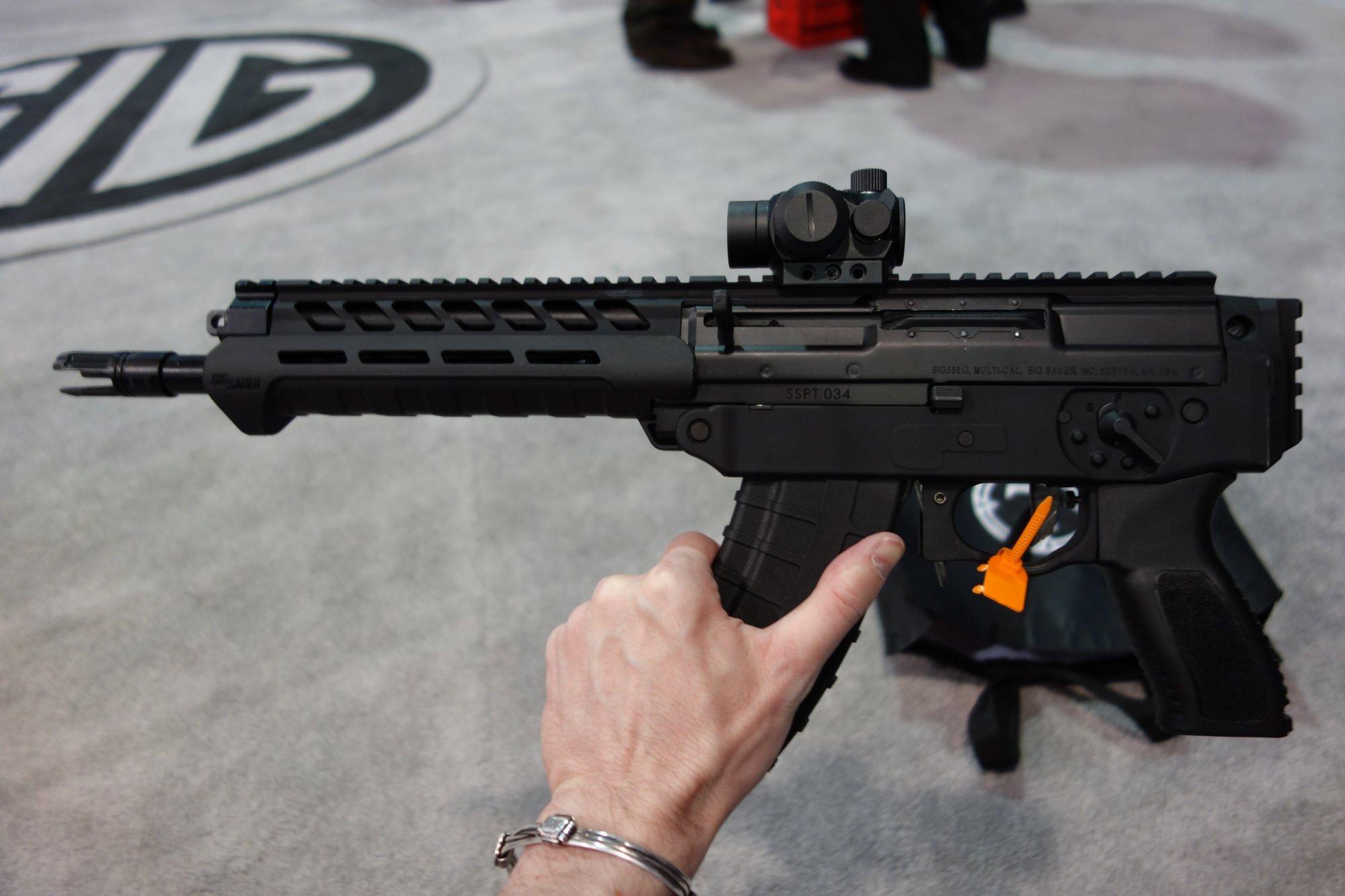 SIG SAUER SIG556xi 7.62x39mm Russian Configuration Semi Auto Only Modular Multi Caliber Combat Tactical Carbine Kalashnikov AK 47 AKM SHOT Show 2014 1 15 14 David Crane DefenseReview.com DR 14 SIG SAUER SIG556xi Modular, Multi Caliber (5.56mm NATO, 300 AAC Blackout/300BLK, 7.62x39mm Russian) Gas Piston/Op Rod Combat/Tactical Rifle/Carbine/SBR with Kalashnikov AK 47/AKM Configuration Capability!