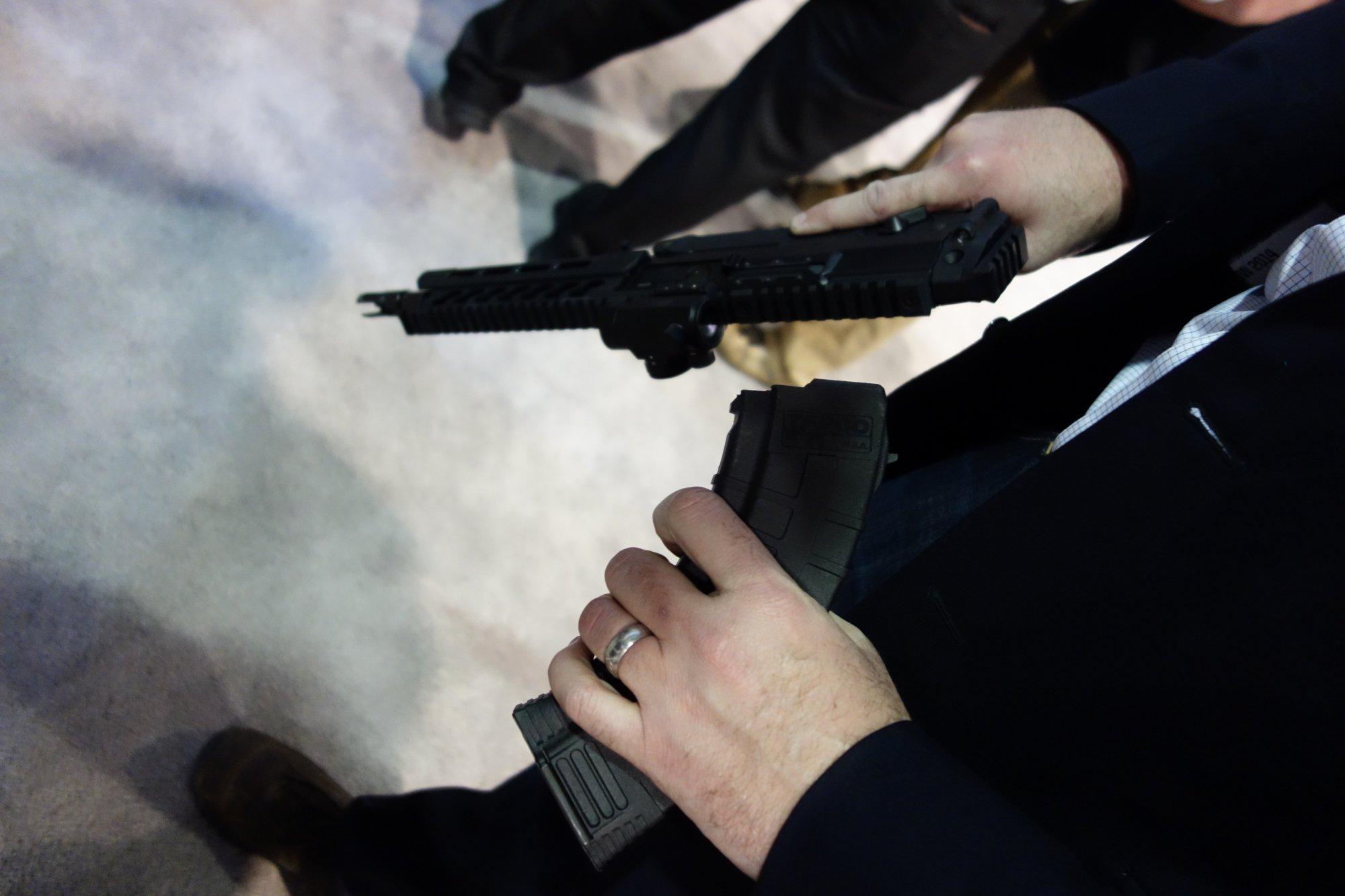 SIG SAUER SIG556xi 7.62x39mm Russian Configuration Semi Auto Only Modular Multi Caliber Combat Tactical Carbine Kalashnikov AK 47 AKM SHOT Show 2014 1 15 14 David Crane DefenseReview.com DR 1 rotated SIG SAUER SIG556xi Modular, Multi Caliber (5.56mm NATO, 300 AAC Blackout/300BLK, 7.62x39mm Russian) Gas Piston/Op Rod Combat/Tactical Rifle/Carbine/SBR with Kalashnikov AK 47/AKM Configuration Capability!