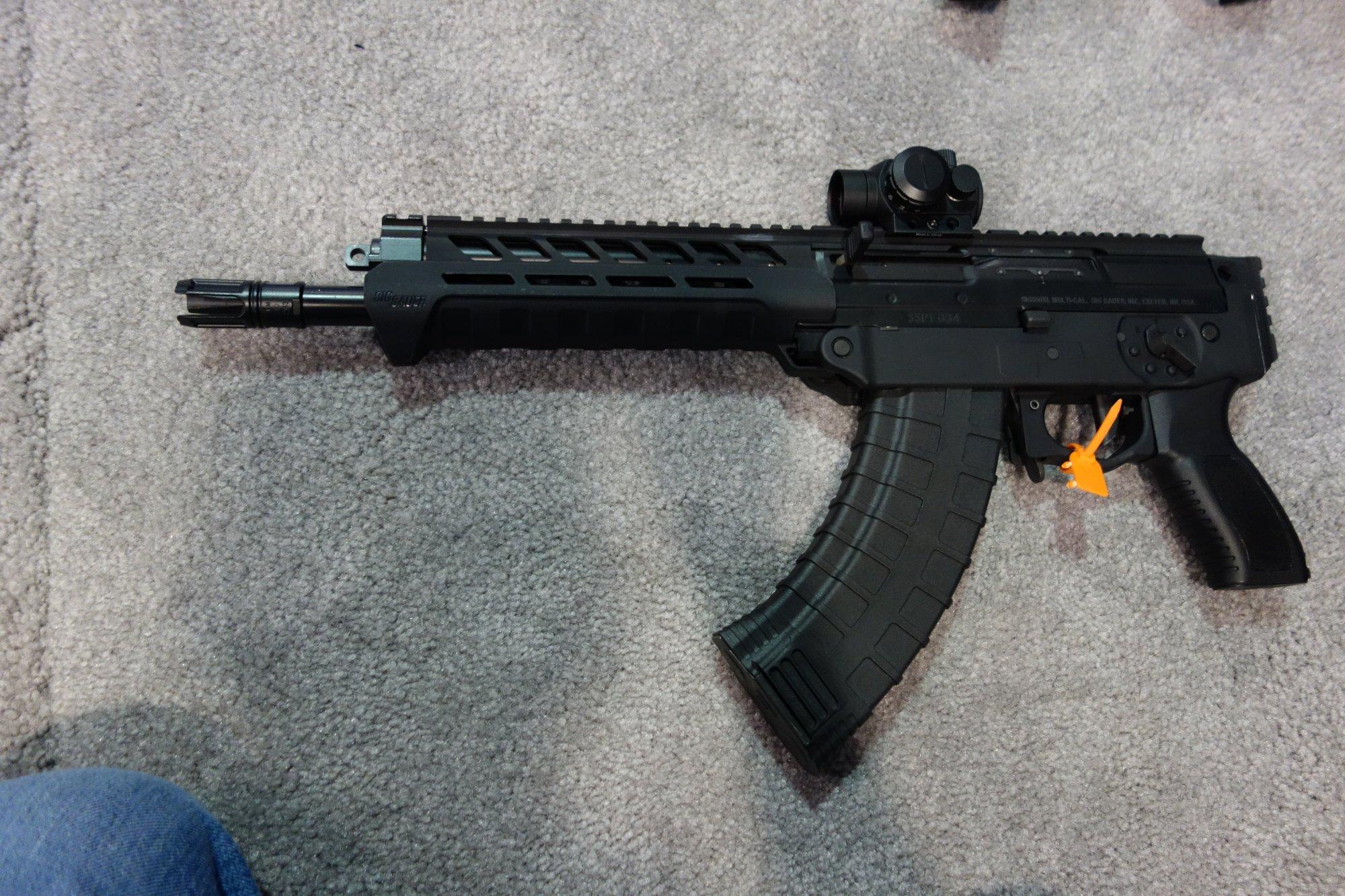 SIG SAUER SIG556xi 7.62x39mm Russian Configuration Semi Auto Only Modular Multi Caliber Combat Tactical Carbine Kalashnikov AK 47 AKM SHOT Show 2014 1 15 14 David Crane DefenseReview.com DR 6 SIG SAUER SIG556xi Modular, Multi Caliber (5.56mm NATO, 300 AAC Blackout/300BLK, 7.62x39mm Russian) Gas Piston/Op Rod Combat/Tactical Rifle/Carbine/SBR with Kalashnikov AK 47/AKM Configuration Capability!