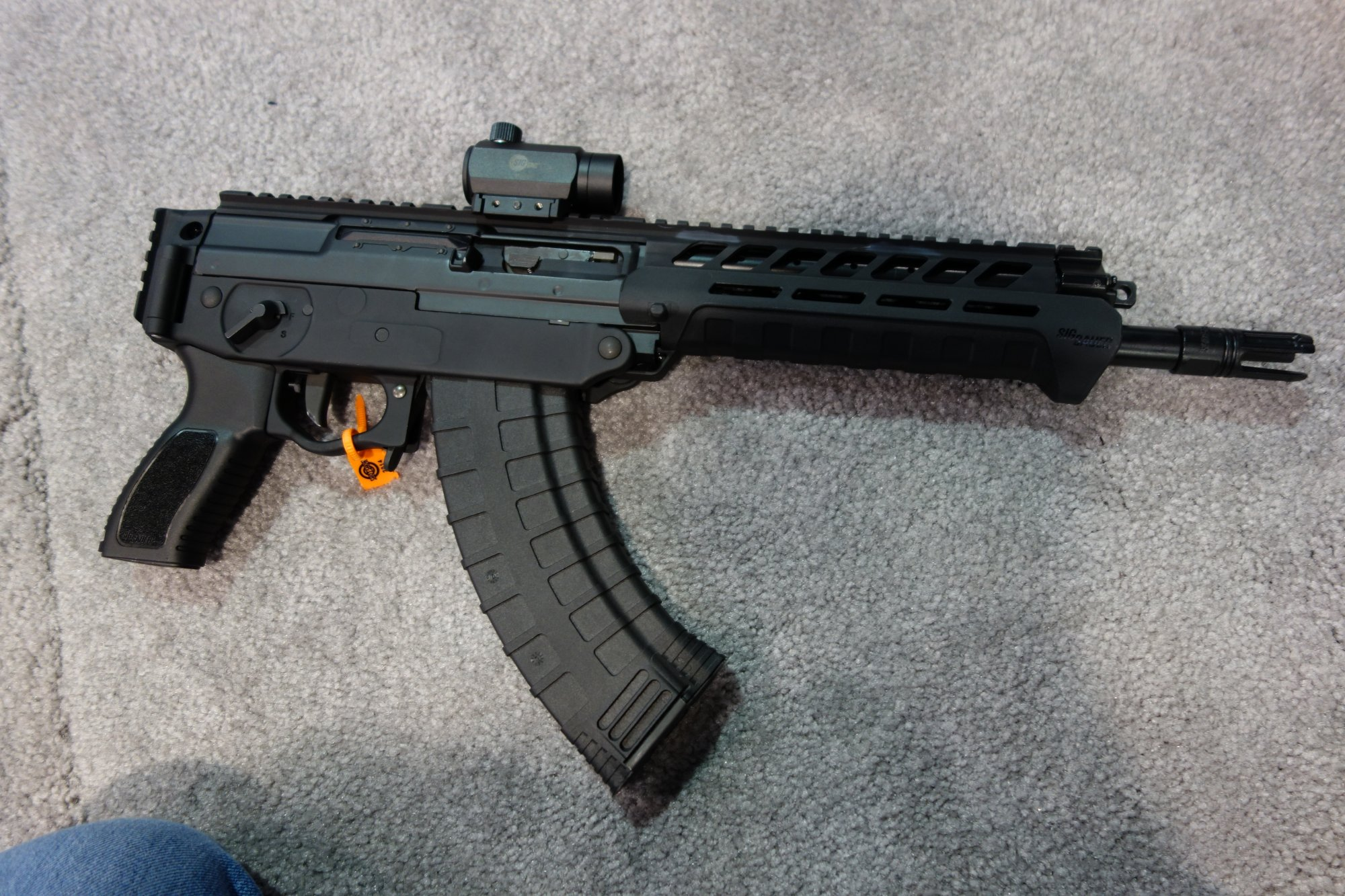 SIG SAUER SIG556xi 7.62x39mm Russian Configuration Semi Auto Only Modular Multi Caliber Combat Tactical Carbine Kalashnikov AK 47 AKM SHOT Show 2014 1 15 14 David Crane DefenseReview.com DR 7 SIG SAUER SIG556xi Modular, Multi Caliber (5.56mm NATO, 300 AAC Blackout/300BLK, 7.62x39mm Russian) Gas Piston/Op Rod Combat/Tactical Rifle/Carbine/SBR with Kalashnikov AK 47/AKM Configuration Capability!