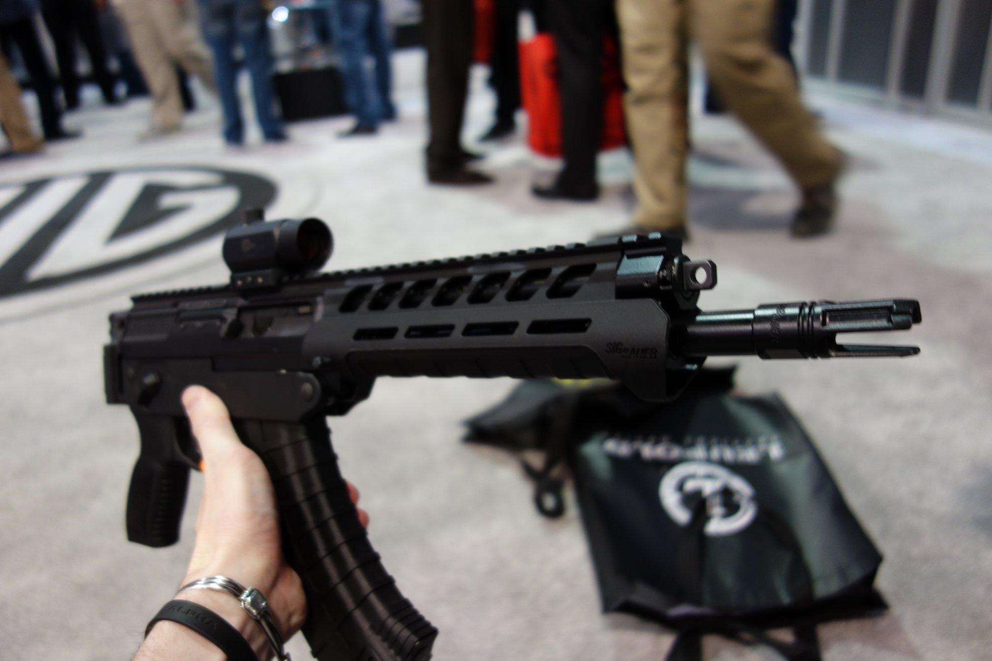 SIG SAUER SIG556xi 7.62x39mm Russian Configuration Semi Auto Only Modular Multi Caliber Combat Tactical Carbine Kalashnikov AK 47 AKM SHOT Show 2014 1 15 14 David Crane DefenseReview.com DR 8 SIG SAUER SIG556xi Modular, Multi Caliber (5.56mm NATO, 300 AAC Blackout/300BLK, 7.62x39mm Russian) Gas Piston/Op Rod Combat/Tactical Rifle/Carbine/SBR with Kalashnikov AK 47/AKM Configuration Capability!