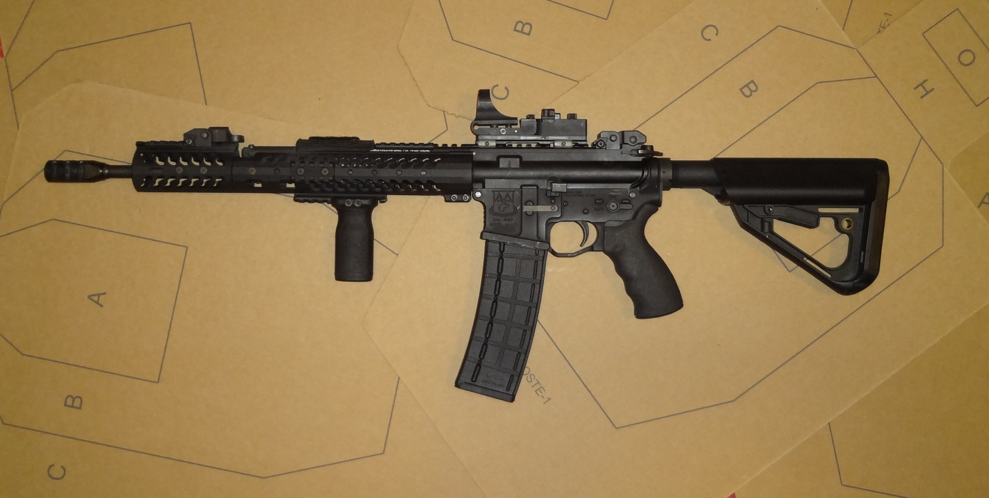 http://www.defensereview.com/wp-content/uploads/2013/09/MWG_IK-520_40-Round_Steel_Reinforced_Polymer_AR-15_Magazine_5.56mm_Mag_in_Adams_Arms_Piston_AR_Carbine_Jeff_Gurwitch_3_small.jpg