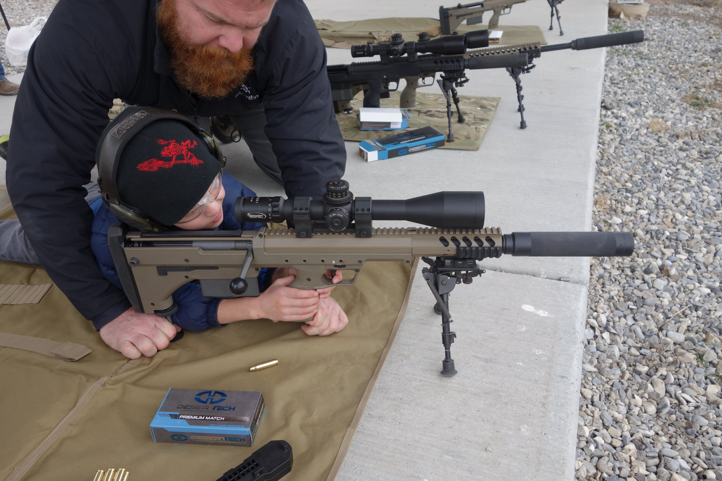 6 Year Old Kid Gets Quick Hits With Suppressed Desert Tech Dt Srs A1 Covert Stealth Recon Scout A1 Covert Bullpup Anti Materiel Sniper Rifle Carbine Defensereview Com Dr An Online Tactical Technology And Military Defense Technology Magazine With